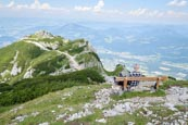 Thumbnail image of Hiker enjoying the view from the Salzburger Hochthron to Geiereck mountain peak, the Hochalm Restaur