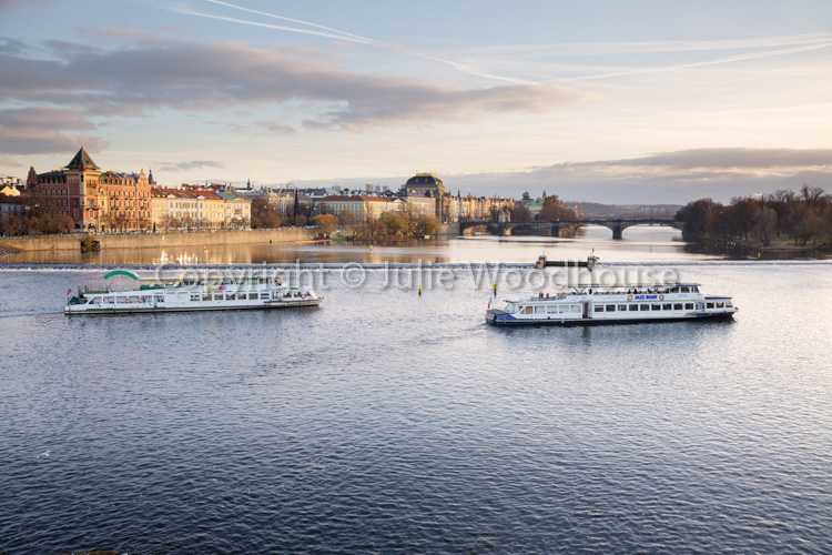 photo showing View Of The Vlatva Rover From The Charles Bridge With Tourist Boats, Prague, Czech Republic