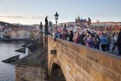 Thumbnail image of tourists walk on the Charles Bridge, Prague, Czech Republic