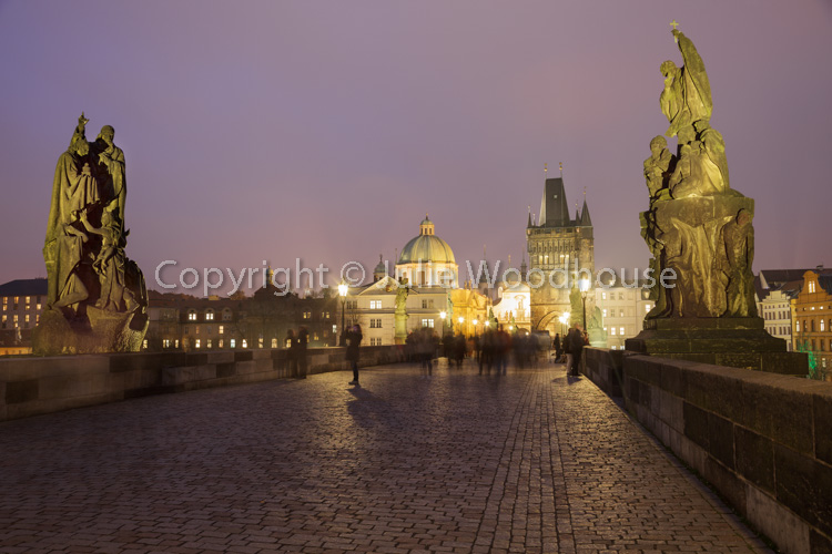 photo showing The Charles Bridge At Night With Old Town Bridge Tower And Statues, Prague, Czech Republic
