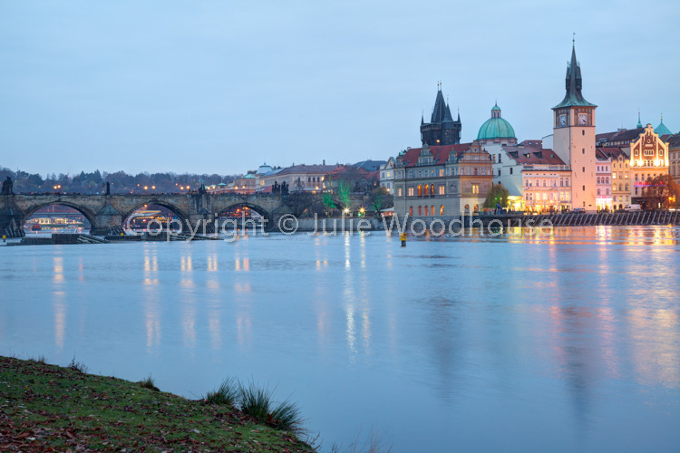 photo showing View Of The Old Town Over The River Vlatva From The Island Střelecký Ostrov, Prague, Czech Republic