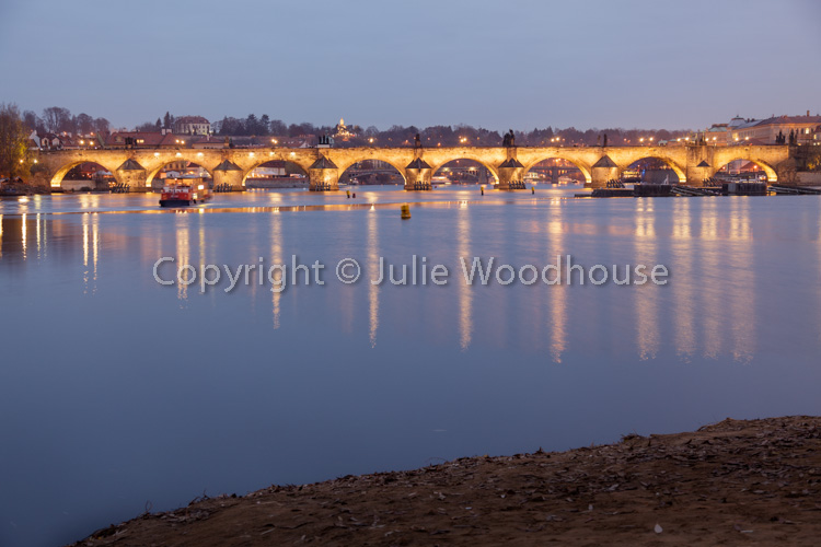 photo showing View Of The Charles Bridge Over The River Vlatva From The Island Střelecký Ostrov, Prague, Czech Rep