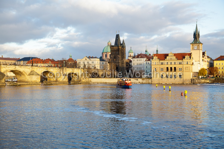 photo showing Tourist Boats On The Vlatva River By The Charles Bridge And The Old Town, Prague, Czech Republic