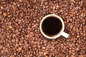Thumbnail image of Cup of coffee with coffee beans