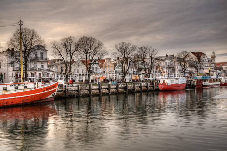 photo showing Old Buildings And Boats On The Alter Strom, Warnemuende, Mecklenburg Vorpommern, Germany