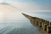 Groynes In The Sea At 
