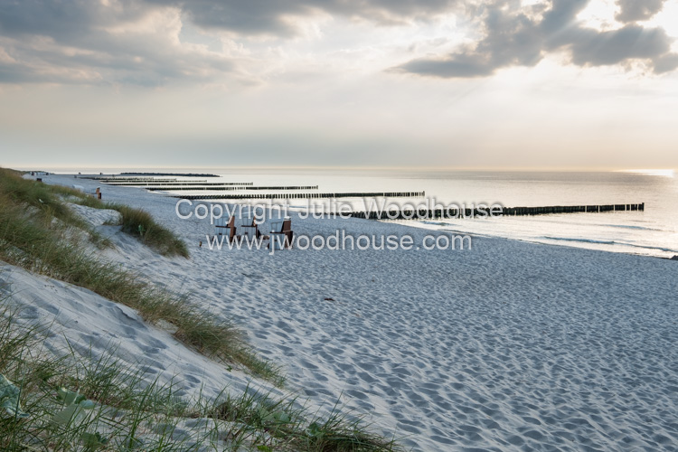 photo showing Beach And Sea With Groynes At Ahrenshoop, Mecklenburg-Vorpommern, Germany