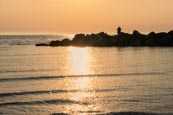 Thumbnail image of sunset over the sea at Ahrenshoop man sea fishing off rocks, Mecklenburg-Vorpommern, Germany