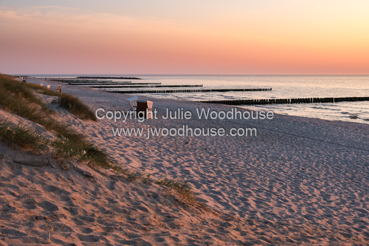 photo showing Beach With Beach Chairs And Sea Groynes At Ahrenshoop, Mecklenburg-Vorpommern, Germany