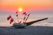 Thumbnail image of fishing boat on the beach at sunset at Ahrenshoop, Mecklenburg-Vorpommern, Germany