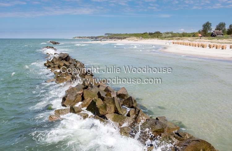 photo showing Wustrow Beach With Breakwater Rocks, Mecklenburg-Vorpommern, Germany