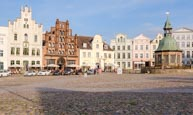 Thumbnail image of Market Square, Am Markt with the Wasserkunst fountain and Alter Schwede restaurant and hotel, Wismar