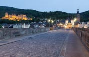 On The Alte Brucke With The Castle Behind, Heidelberg, Baden-Württemberg, Germany