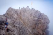 Thumbnail image of people on the Zugspitze summit by the summit cross, Bavaria, Germany