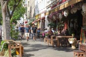 Thumbnail image of Bergmannstrasse in Kreuzberg people walking and sitting outside Umami Restaurant, Berlin, Germany