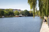 Thumbnail image of Landwehr Canal, Kreuzberg people sitting on the Böcklerpark and leisure boats on the canal, Berlin,