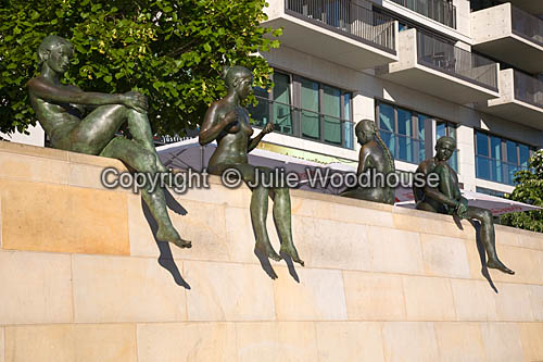 photo showing Sunbather Statues By River Spree, Berlin, Germany