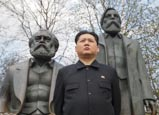 Thumbnail image of Kim Jong Un impersonator with Marx and Engels statue, Berlin
