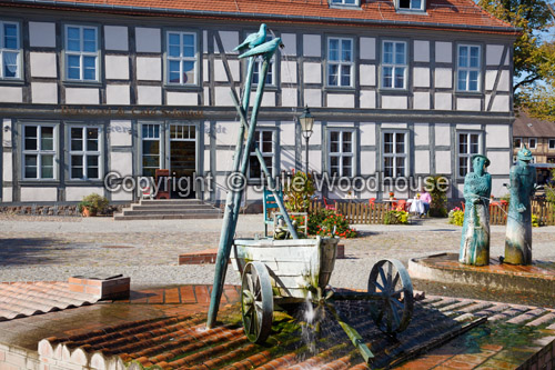photo showing Market Place With Fountain And Sculptures By Christian Uhlig, Angermuende, Brandenburg, Germany