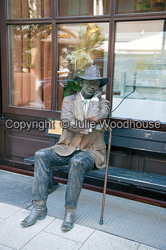 photo showing Sidewalk Judge Statue By J Seward Johnson Jr. In Luisenstrasse, Hannover, Lower Saxony, Germany