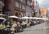 Thumbnail image of Am Stintmarkt with people sitting outside restaurants, Luneburg, Lower Saxony, Germany