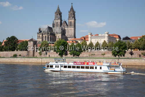 photo showing Tourist Boat On The River Elbe With The Cathedral And Fürstenwall, Magdeburg, Saxony Anhalt, Germany