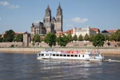 Tourist Boat On The River Elbe With The Cathedral And Fürstenwall, Magdeburg, Saxony Anhalt, Germany