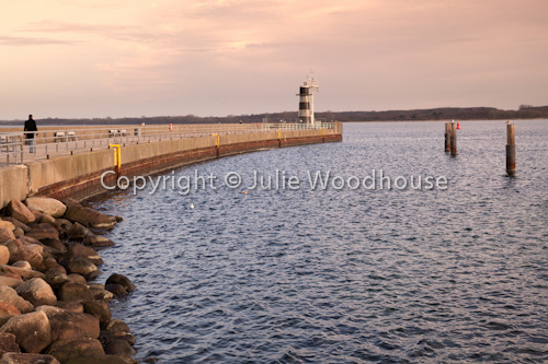 photo showing Lighthouse North Mole, Travemuende, Schleswig-Holstein, Germany