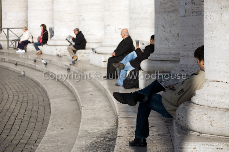 photo showing St Peters - People Relaxing On The Colonnade, Rome, Italy