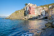 View Over The Town And Harbour With Its Colourful Houses In Riomaggiore, Cinque Terre, Liguria, Ital