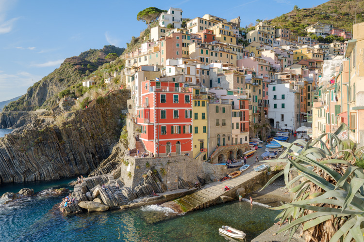 photo showing View Over The Town And Harbour With Its Colourful Houses In Riomaggiore, Cinque Terre, Liguria, Ital