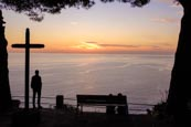Man Viewing The Sunset View Of The Coast By A Cross From Riomaggiore, Cinque Terre, Liguria, Italy
