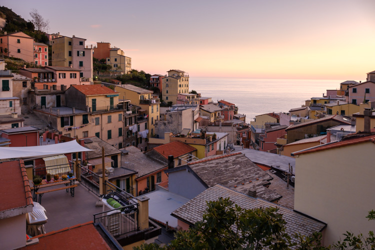 photo showing View Over The Town With Its Colourful Houses In Riomaggiore, Cinque Terre, Liguria, Italy