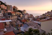 View Over The Town With Its Colourful Houses In Riomaggiore, Cinque Terre, Liguria, Italy