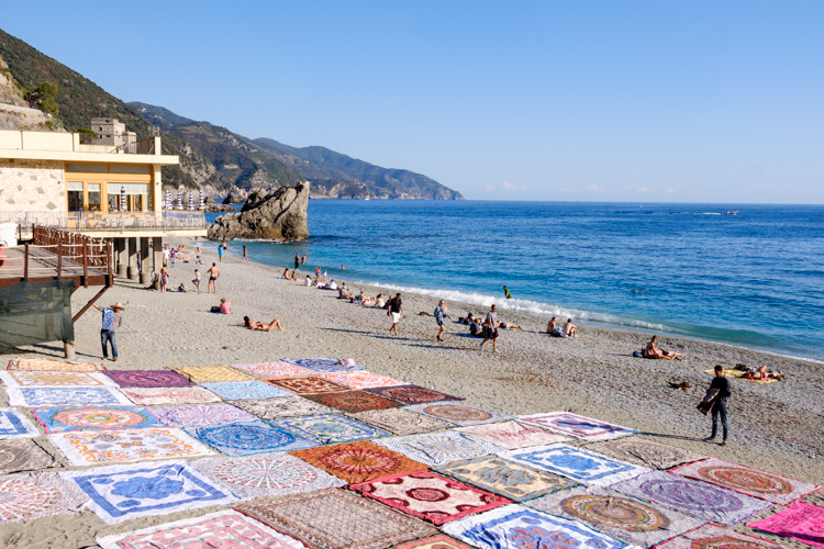 photo showing Beach At Monterosso With Colourful Beach Throws, Liguria, Italy