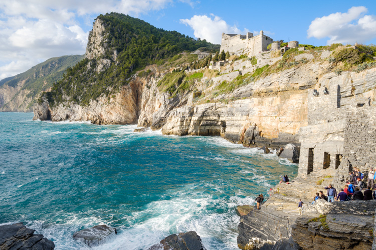photo showing Coastline At Porto Venere With The View Up To The Castle Doria And The Byron Grotto, Porto Venere, L