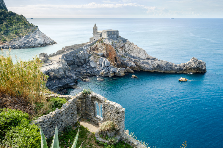 photo showing View Over Porto Venere With The Church Of St. Peter And Byron Grotto, Liguria, Italy