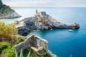 View Over Porto Venere With The Church Of St. Peter And Byron Grotto, Liguria, Italy