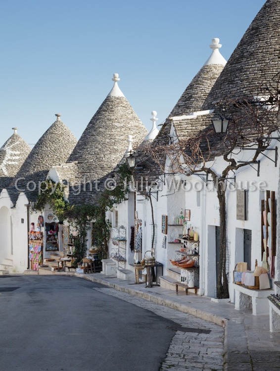 photo showing Trulli Souvenir Gift Shops In Alberobello, Puglia, Italy