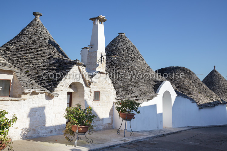 photo showing Typical Trulli In The Aia Piccola  District In Alberobello, Puglia, Italy