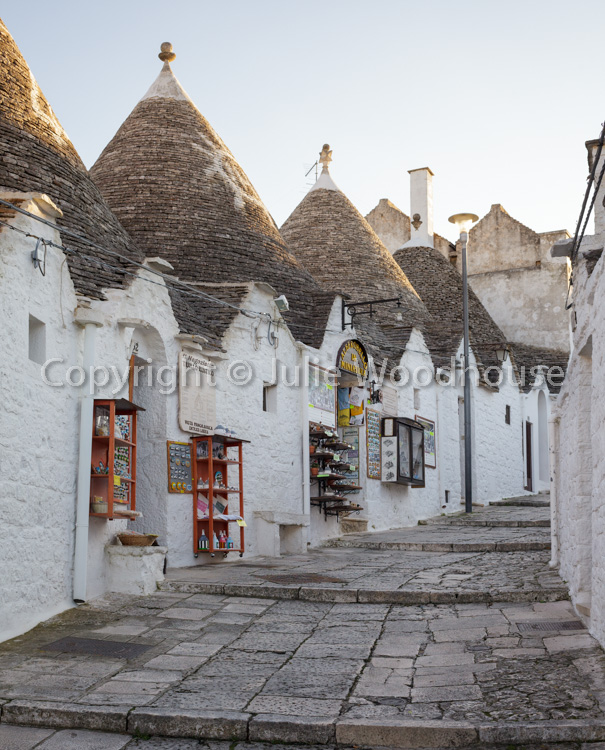 photo showing Typical Trullis With Shops In Alberobello, Puglia, Italy