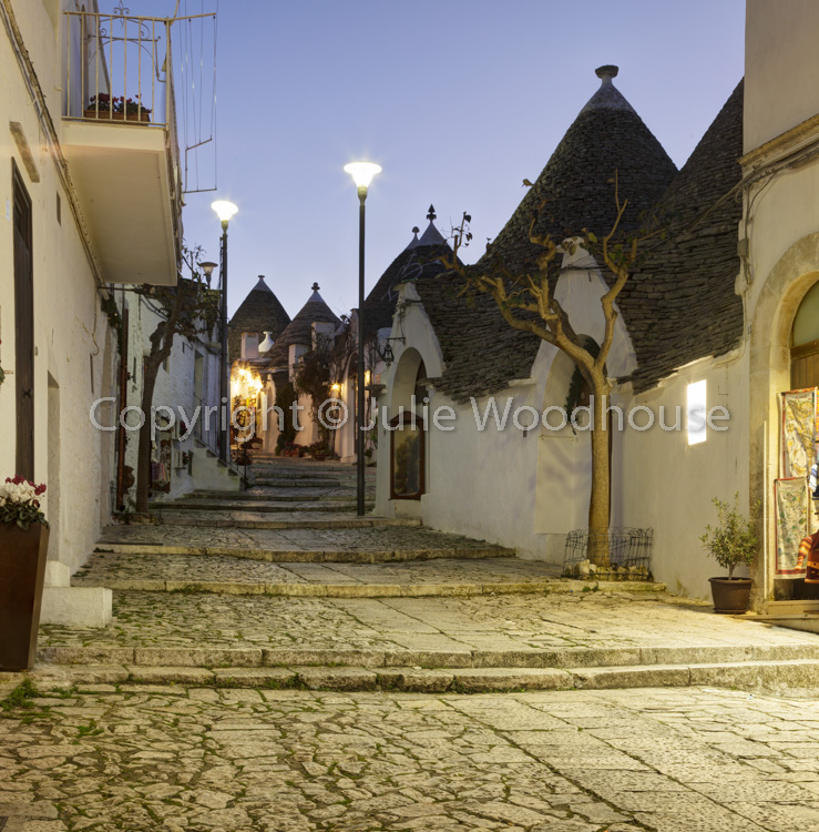 photo showing Street And Shops In The Trulli District Rione Monti In Alberobello, Puglia, Italy