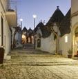 Thumbnail image of street and shops in the trulli district Rione Monti in Alberobello, Puglia, Italy