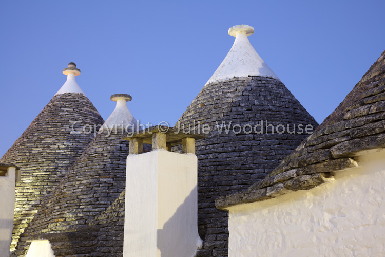 photo showing Typical Trulli In Alberobello, Puglia, Italy