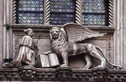 Thumbnail image of Doges Palace, Doge Foscari and Lion of St Mark, detail over Porta della Carta, Venice