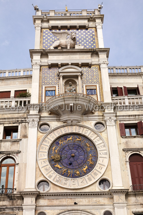 photo showing Clock Tower In St Marks Square, Venice, Veneto, Italy