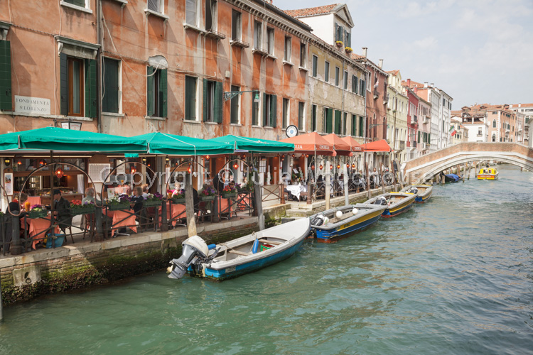photo showing Canal With Outdoor Restaurant On Fondamenta San Lorenzo, Venice, Veneto, Italy