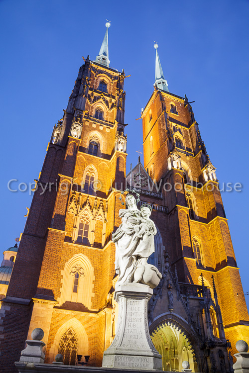 photo showing Cathedral Of St. John The Baptist With Statue Of Mary And Child, Wroclaw, Poland