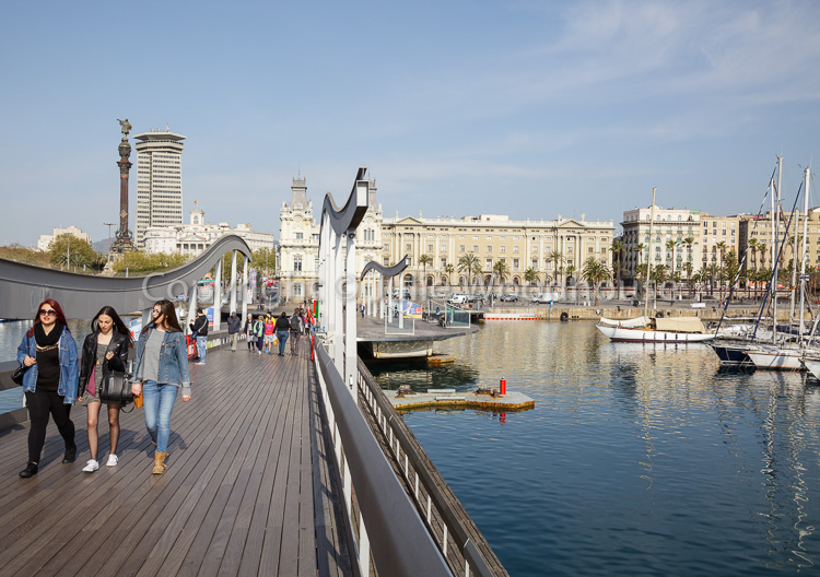 photo showing Rambla De Mar With View To Mirador De Colom, Barcelona, Catalonia, Spain