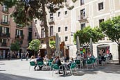 Thumbnail image of Placa del Pi in the Barri Gotic, people sitting outside the Cafe Osterhase beneath orange trees, Bar
